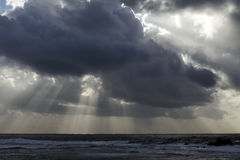 Stormy sea sky with sunbeams. Stormy sea sky with dark clouds and sunbeams. Northern portuguese coast in November Royalty Free Stock Images