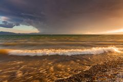 Stormy sea at sunset. Beautiful sky and waves Royalty Free Stock Photo