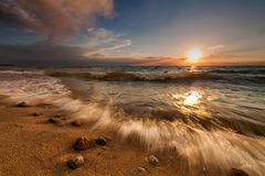 Stormy sea at sunset. Beautiful sky and waves Stock Image