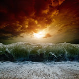 Stormy sea, sunset. Dramatic nature background - big wave, stormy sea, red sunset Royalty Free Stock Images