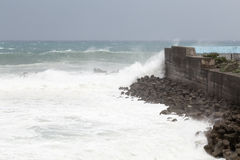 Stormy sea during typhoon, waves crashing on barrier wall Royalty Free Stock Photo