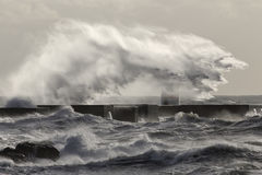 Stormy sea wave splash and spray. Interesting big stormy sea wave splash and spray. Douro river mouth north new pier, Porto, Portugal, in January Royalty Free Stock Photos