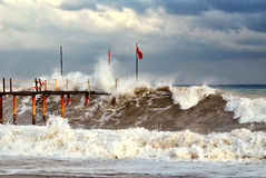 Stormy sea waves around the pier Stock Image