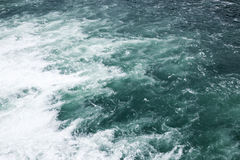 Stormy sea, waving deep blue water surface. With foam, natural background photo Stock Photo