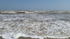 Stormy sea. A windy day at the sea with lots of waves and foam near the shore Stock Photography