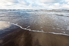 Stormy sea in winter with white waves crushing Stock Images