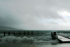 Stormy Seas. Stormy waves crashing on jetty stock image