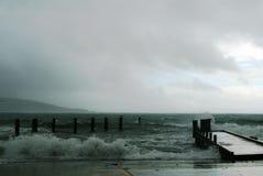 Stormy Seas. Stormy waves crashing on jetty Stock Image