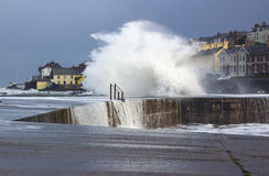 Stormy seas break over the sea wall at the Long Hole in Bangor, County Down during rough seas in a storm in January 2017. This old harbor is avital part of stock image