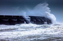 Stormy seas hitting Brighton Marina. Waves hitting Brighton Marina during a storm stock image