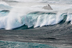 Stormy seas. Large wave breaking off the coast of Corralejo in stormy whether Stock Photography