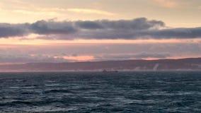 Stormy seas with mountains. Seas with mountains in background stock photos