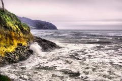 Stormy seas on the Oregon coast. Waves and frothy water along the Oregon coastline stock photo