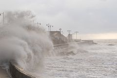 Stormy seas at Porthcawl, South Wales, UK. Porthcawl, South Wales, UK. 5 January 2017. UK weather: Huge waves along the seafront this morning as the stormy royalty free stock images
