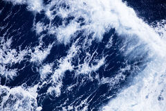 Stormy seas on a sunny day royalty free stock photo