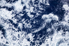 Stormy seas on a sunny day stock photography
