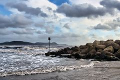 Stormy Seas At Lyme Regis. Stormy seascape with dark clouds and rough seas at Lyme Regis, dorset stock images