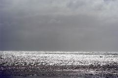 Stormy seascape, horizontal. Sunlight glistening on a stormy sea Royalty Free Stock Photo
