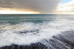 Stormy seascape at sunset Stock Image