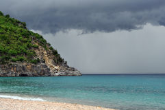 Stormy shell beach in St.Barth. St.Barth, June 2011 - Stormy shell beach with dark clouds royalty free stock photos
