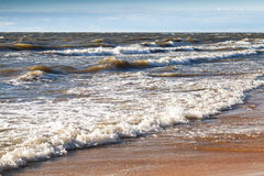 Stormy shore water and sandy coast Royalty Free Stock Photo