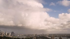 Stormy skies clearing over Sydney`s city skyline time lapse
