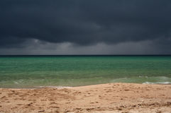Stormy Skies. In the distant on a beach in Thailand Royalty Free Stock Images
