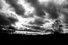 Stormy skies. Dramatic stormy clouds in the sky, shot in black and white Stock Photography