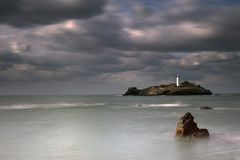 Free Stormy Skies Over Godrevy Lighthouse On Godrevy Island In St Ives Bay With The Beach And Rocks In Foreground, Cornwall Uk Royalty Free Stock Photos - 111139658