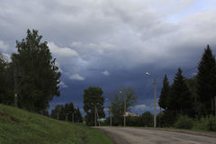 Stormy skies over the village in early morning Royalty Free Stock Images