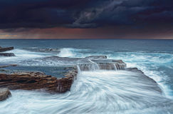 Stormy skies at sunrise Stock Photo