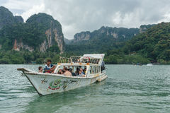 Stormy sky above mountain and tourist boat at Railay beach royalty free stock images
