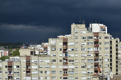 Stormy Sky above Tall Buildings Royalty Free Stock Images