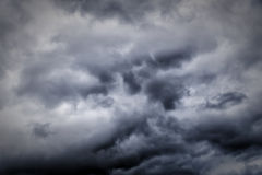 Stormy Sky Background. Dark ominous clouds create a dramatic sky background royalty free stock photos
