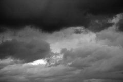 A stormy sky in the bb. Clouds. Dark ominous grey storm clouds. Dramatic sky royalty free stock image