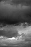 A stormy sky in the bb. Clouds. Dark ominous grey storm clouds. Dramatic sky stock photo