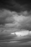 A stormy sky in the bb. Clouds. Dark ominous grey storm clouds. Dramatic sky stock images