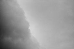 A stormy sky in the bb. Clouds. Dark ominous grey storm clouds. Dramatic sky royalty free stock photos
