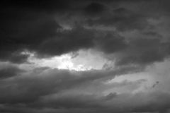 A stormy sky in the bb. Clouds. Dark ominous grey storm clouds. Dramatic sky stock photos