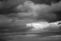 A stormy sky in the bb. Clouds. Dark ominous grey storm clouds. Dramatic sky stock photography