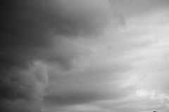 A stormy sky in the bb. Clouds. Dark ominous grey storm clouds. Dramatic sky royalty free stock images