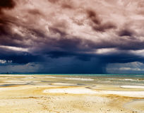 Stormy sky and beach at low tide Stock Image