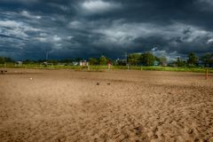 Stormy sky and a beach of White lake royalty free stock photo