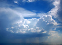 Stormy sky with clouds. In the rain over the sea royalty free stock image