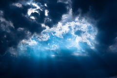 Stormy sky. Stormy dark-blue sky with a dramatic sunbeam royalty free stock photography