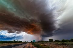 Stormy sky with dark clouds ahead of a supercell thunderstorm. Stormy sky with dark clouds illuminated by sunset as a supercell thunderstorm approaches Belen stock images