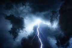 Stormy sky. Dramatic nature background - bright lightning in dark stormy sky Royalty Free Stock Images
