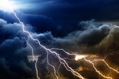 Stormy sky. Dramatic nature background - bright lightnings in dark stormy sky royalty free stock photos
