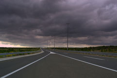 Stormy sky highway Stock Images