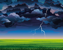 Stormy sky with lightning and green field Stock Photo